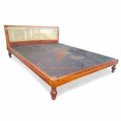 carved teakwood bedframe in maroon finish