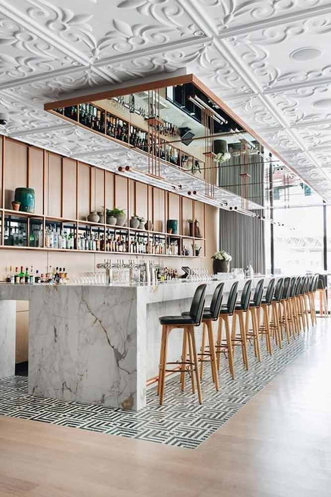 Modern Bar Counter in Marble with Recessed Seating Section for a Contemporary-Theme Commercial Bar