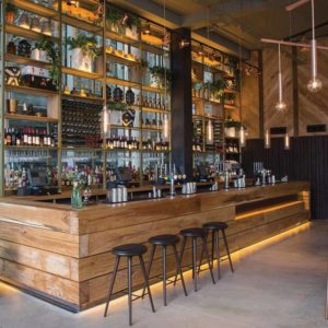 Wooden Bar Counter with Wood Pallet Panelled Facade and Recessed Lighting for Rustic Resto Bar
