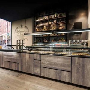 Industrial Cafe Counter with Recessed Lighting and Glass Food Display and Storage Shelf