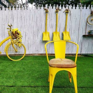 vibrant patio style garden with yellow furniture