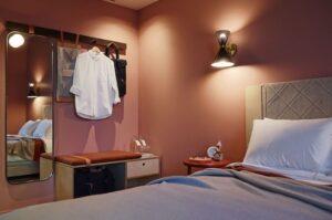 minimalistic hotel room wardrobe in dim lighting