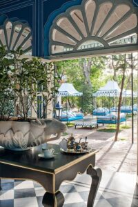 outdoor area of an Iindian hotel with bright interiors