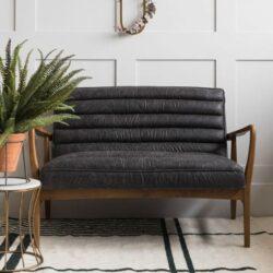 Sofa aus schwarzem Stoff in Used-Optik