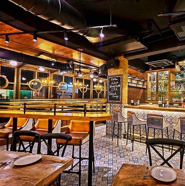 Modern restaurant furniture installation  - Client of FurnitureRoots India